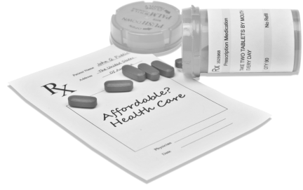 photo of an RX Form with an opened medicine container and medicine capsules on top