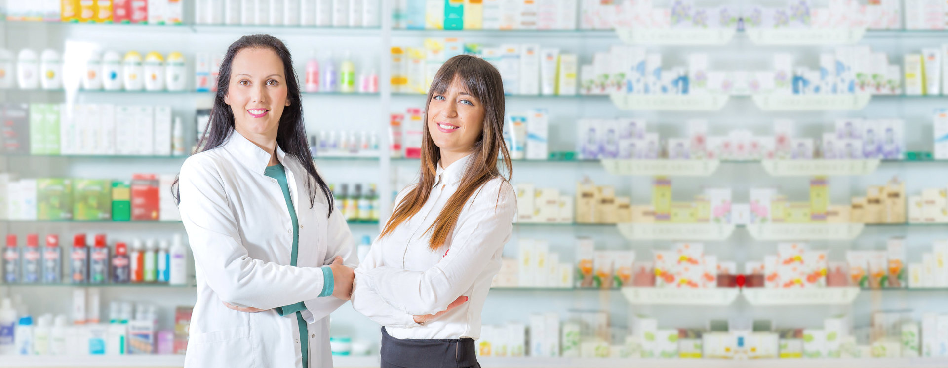 photo of women pharmacists with pharmacy products on background