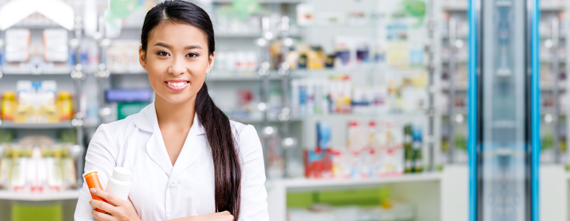 photo of a woman pharmacist holding pharmacy products
