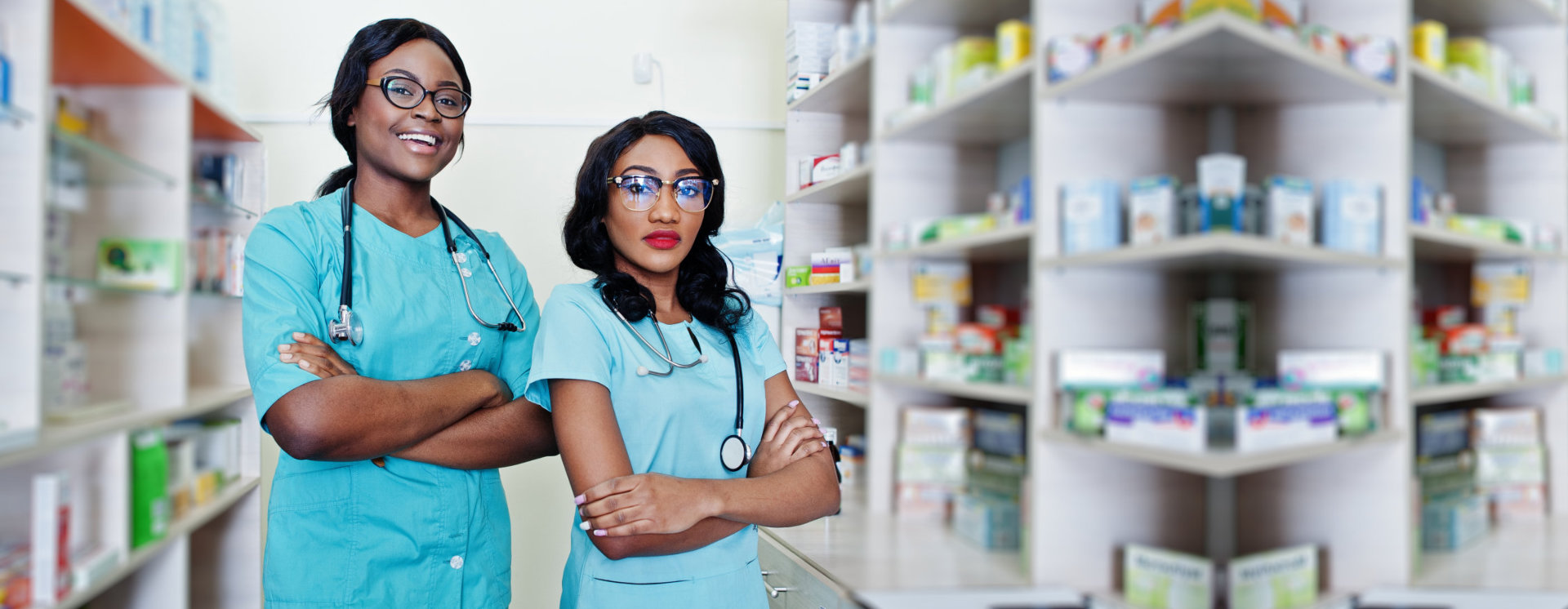 two medical personel with stethoscope with pharmacy products on background